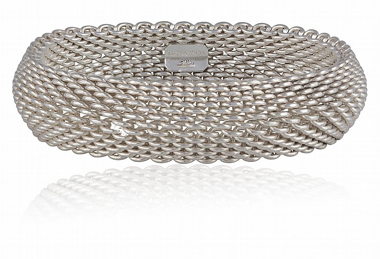 A SILVER BRACELET, BY TIFFANY & CO.The mesh bracelet, mounted in 925 silver, Signed Tiffany & Co, with maker's pouch and box, inner diameter approximately 5.8cm