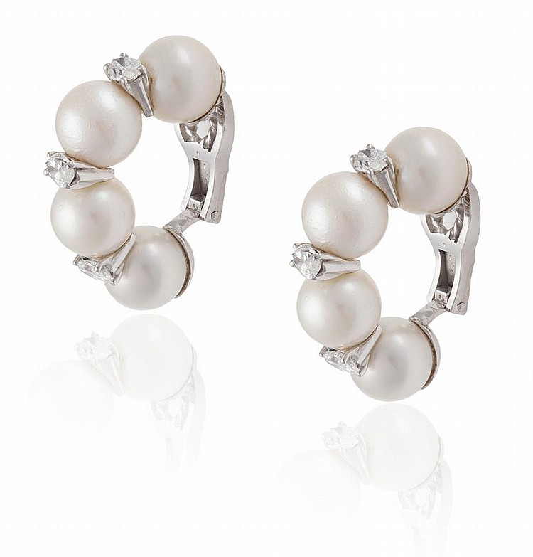 A PAIR OF CULTURED PEARL AND DIAMOND EARCLIPSEach designed as a scroll of cultured pearls, accented with marquise-shaped diamonds, diamonds approximately 1.20cts total, length 3.1cm