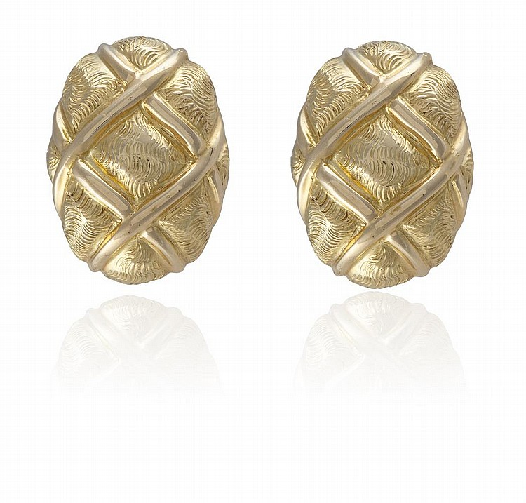 A PAIR OF GOLD EARCLIPS, BY TIFFANY & CO.Each designed as a stylised bombé clip with crossed rope motifs, mounted in 18K gold, signed Tiffany & Co., length 2.4cm