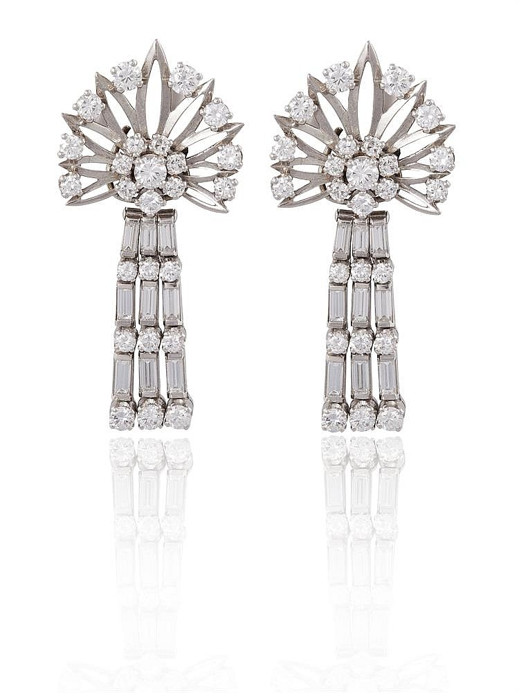 A PAIR OF DAY & NIGHT COCKTAIL PENDENT EARRINGS, CIRCA 1950Each floral design cluster set with round brilliant-cut diamonds, suspending a detachable three-row tassel, each set with round and baguette-cut diamonds, diamonds approximately 3.30cts to