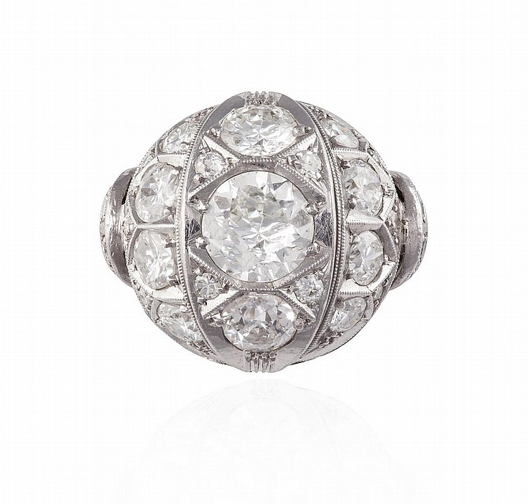 A DIAMOND DRESS RING, CIRCA 1950Of bombé design, centrally set with a round brilliant-cut diamond, within a similarly-cut diamond surround, mounted in 9K gold, diamonds approximately 3.50cts total, French assay mark, ring size M
