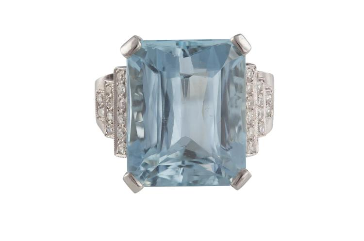 AN AQUAMARINE AND DIAMOND RINGThe rectangular-cut aquamarine weighing approximately 27.00cts, between tapering shoulders of round brilliant-cut diamonds, to an openwork gallery of intricate design, diamonds approximately 0.30ct total, ring size M