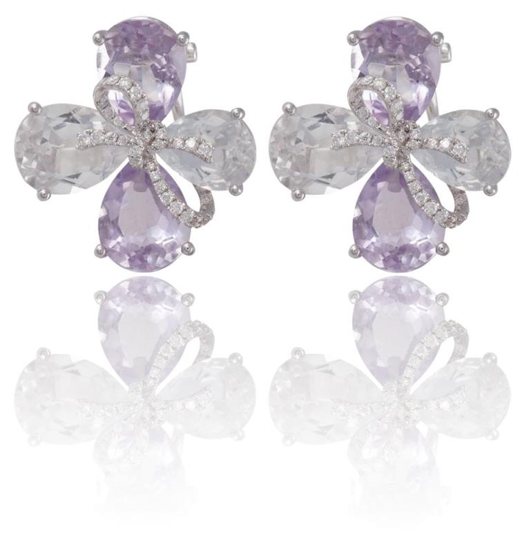A PAIR OF AMETHYST, TOPAZ AND DIAMOND EARRINGSEach earring designed as a flower, the petals set with two pear-shaped amethyst and two colourless topaz similarly-shaped, a diamond pavé-set bow to the centre, mounted in 18K gold, signed Kiki, length 2
