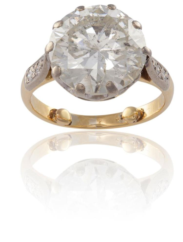 A DIAMOND SINGLE-STONE RINGThe old brilliant-cut diamond, weighing approximately 6.50cts, between two brilliant-cut diamond shoulders, ring size I¾