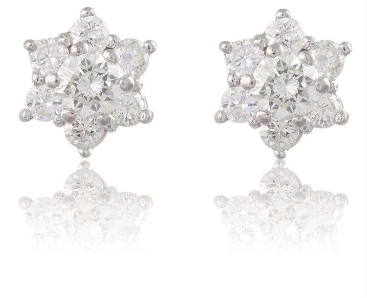 A PAIR OF DIAMOND EAR STUDSEach centred by a round brilliant-cut diamond, to a surround of similarly-cut diamonds, mounted in 14K gold, diamonds approximately 0.50ct total, length 7mm