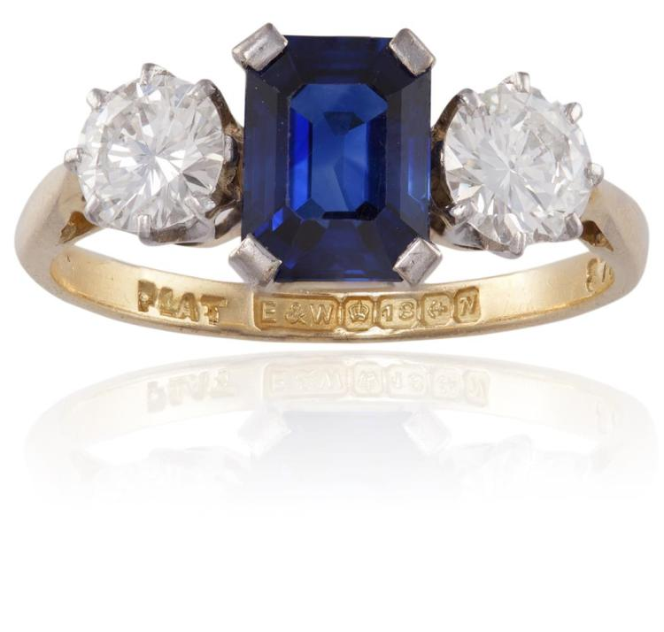 A SAPPHIRE AND DIAMOND RINGThe octagonal-cut sapphire in a four-claw setting, between two round brilliant-cut diamonds, mounted in 18K gold, diamonds approximately 0.80ct total, ring size N½Accompanied by a report from GCS laboratory in London, sta