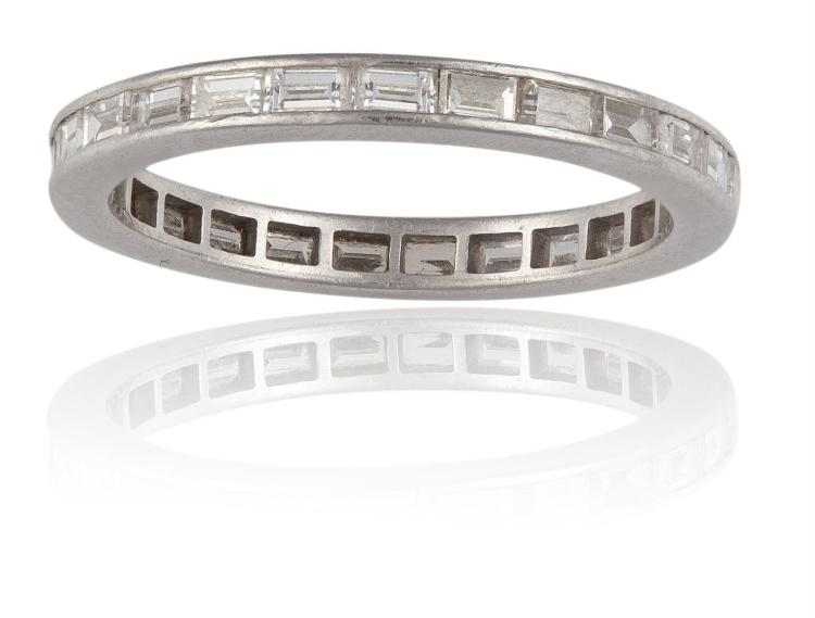 A DIAMOND ETERNITY RINGComposed of a continuous row of baguette-cut diamonds, within a channel setting, diamonds approximately 1.00ct total, ring size L½
