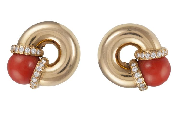 A PAIR OF CORAL AND DIAMOND EARCLIPSEach designed as a round hoop, set with a coral bead with round brilliant-cut diamond accents, mounted in 18K gold, French import marks, length 2cm