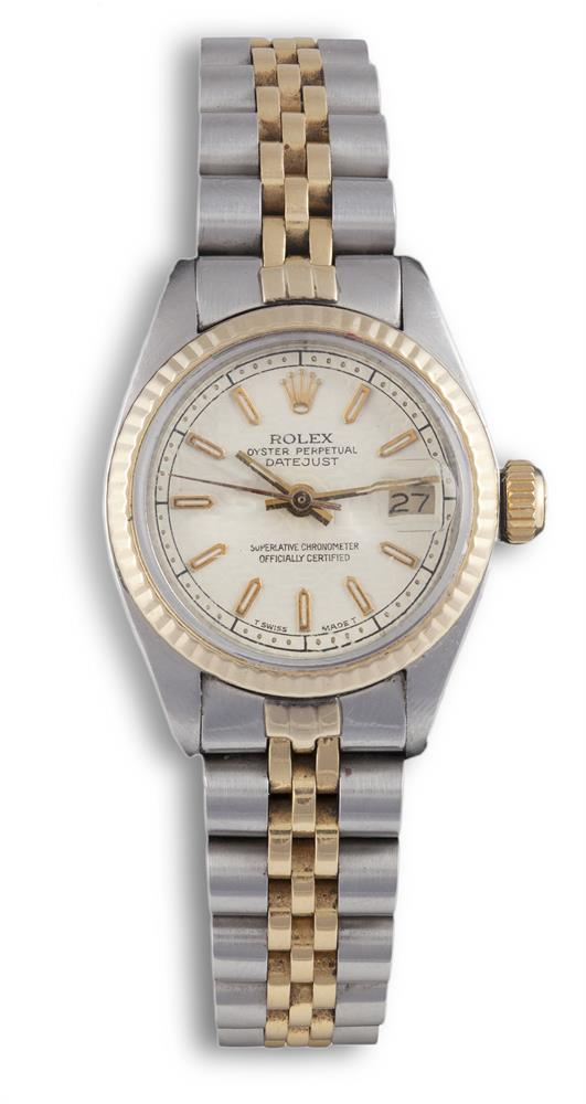 A STAINLESS STEEL AND GOLD CALENDAR BRACELET WATCH, BY ROLEX, CIRCA 1978The 23-jewel self winding movement, cream dial with baton numerals, magnified date aperture at 3 o'clock, gold hands, fixed fluted bezel, polished tonneau form case with screw d