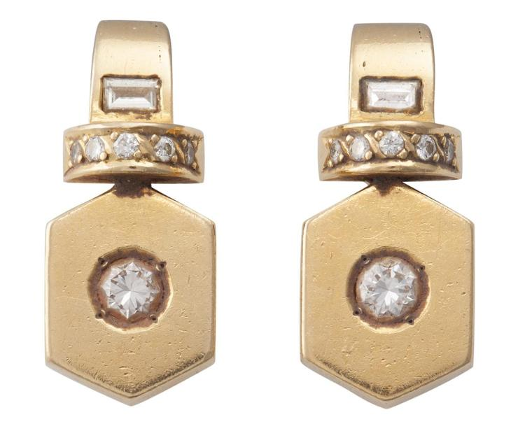 A PAIR OF DIAMOND AND GOLD EARCLIPS Each designed as an octagonal-shaped plaque, set to the centre with a round brilliant-cut diamond, accented by brilliant and baguette-cut diamonds, mounted in 18K gold, diamonds approximately 0.50ct total, length