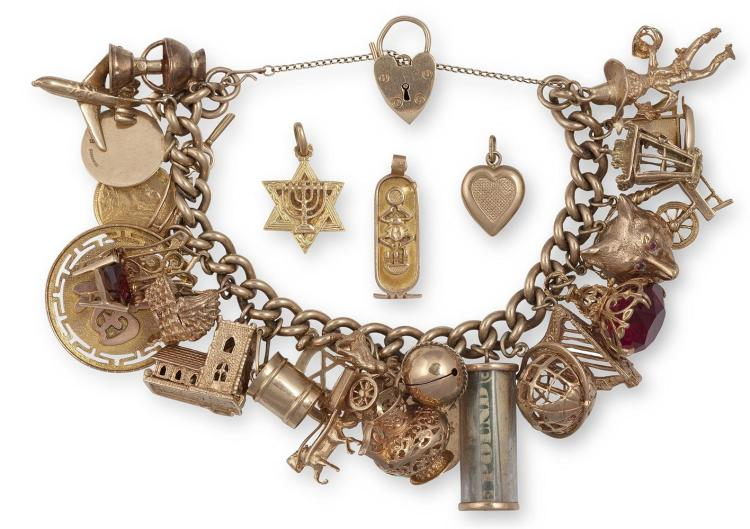 A GEM-SET AND GOLD CHARM BRACELETThe curb-link bracelet with security chain, suspending 26 assorted charms, including a heart-locket, a harp, a fox, a coin etc...mounted in 9K gold, with four additional loose charms, weight approximately 158g total