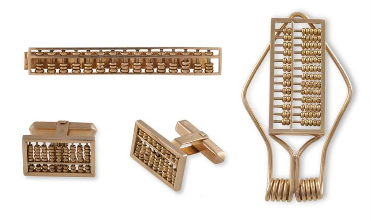 A GENTLEMAN'S GOLD DRESS SETEach designed as an abacus, the set includes a pair of cufflinks, a money clip and a tie clip, each mounted in 18K gold, approximately 33g total