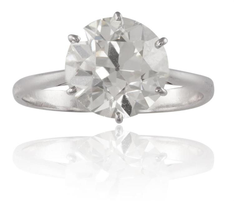 A DIAMOND SINGLE-STONE RINGThe round brilliant-cut diamond, weighing approximately 3.50cts, set within a six-claw setting, to a plain hoop, mounted in 18K gold, French assay mark, ring size O
