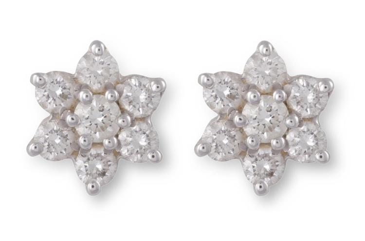 A PAIR OF DIAMOND EAR STUDSEach centred by a round brilliant-cut diamond, to a surround of similarly-cut diamonds, mounted in 18K gold, diamonds approximately 0.40ct total, cased from West of Grafton Street, Dublin