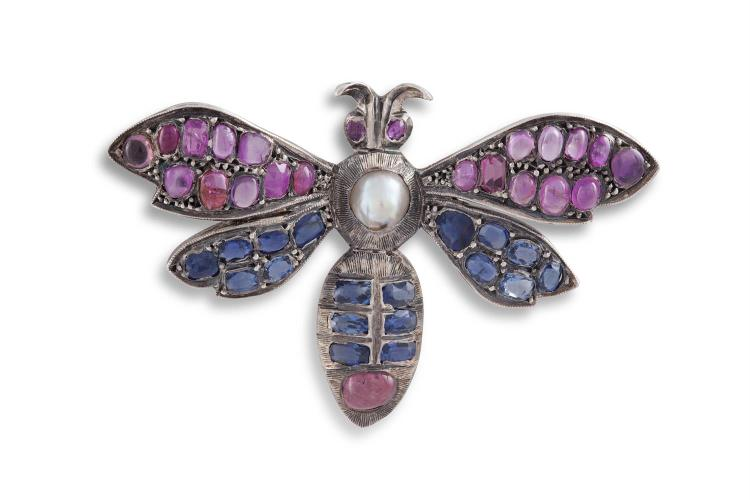 A SAPPHIRE AND PEARL BUTTERFLY BROOCHThe stylised butterfly set throughout with cushion-cut and cabochon coloured sapphires, mounted in silver, French assay mark, length 3.5cm, width 5.5cm* Please note that the pearl has not been tested