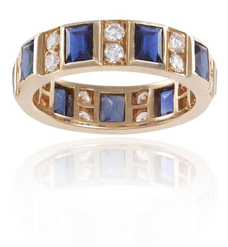 A SAPPHIRE AND DIAMOND ETERNITY RINGThe continuous row of rectangular-cut sapphires, alternating with a duo of round brilliant-cut diamonds, mounted in 18K gold, diamonds approximately 0.50ct total, French import mark, ring size N