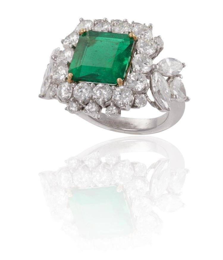 AN EMERALD AND DIAMOND DRESS RINGThe square step-cut emerald, weighing approximately 3.50cts, within a surround of round brilliant-cut diamonds, with further marquise and pear-shaped diamond shoulders, mounted in 18K gold and platinum, diamonds appr