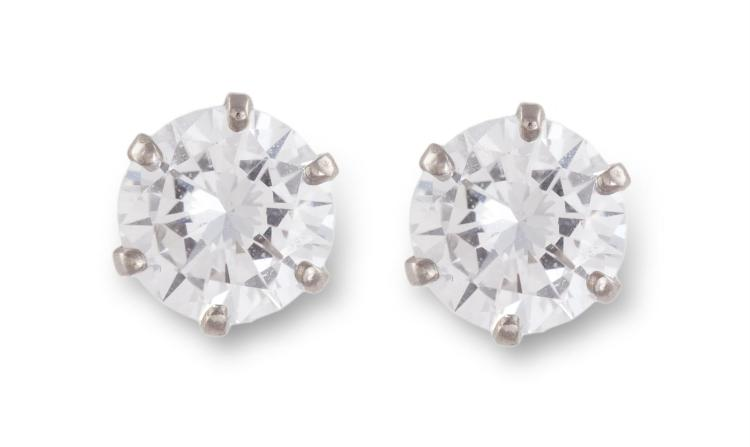 A PAIR OF DIAMOND EAR STUDSThe round brilliant-cut diamonds, weighing 0.50 & 0.54ct, within a six-claw setting, mounted in 18K gold, with French assay marks
