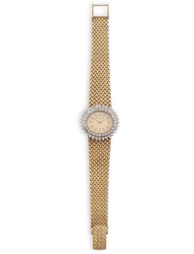 A LADY'S GOLD AND DIAMOND-SET BRACELET WATCH, BY GIRARD-PERREGAUXThe 17-jewel manual wind movement with an oval-shaped dial with baton indicators, within a double brilliant-cut diamond bezel, on an integral mesh strap , diamonds approximately 1.30ct