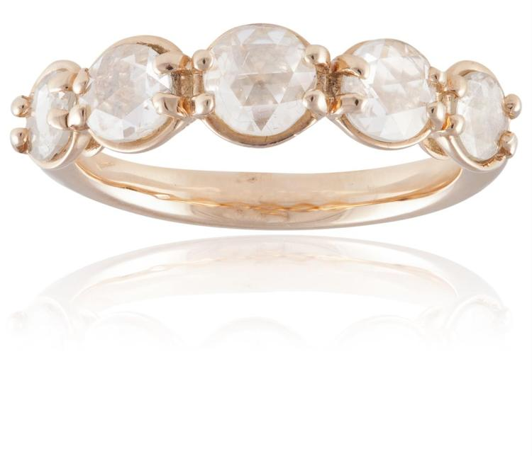 A DIAMOND FIVE-STONE RINGComposed of five graduating rose-cut diamonds, each within a four-claw setting, ring size N½