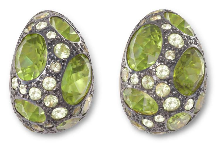 A PAIR OF PERIDOT TABOU EARRINGS, BY POMELLATOEach clip of bombé design, set throughout with oval and round-shaped peridots, mounted in 18K gold and 925 silver, signed Pomellato, Italian assay marks, length 2.8cm