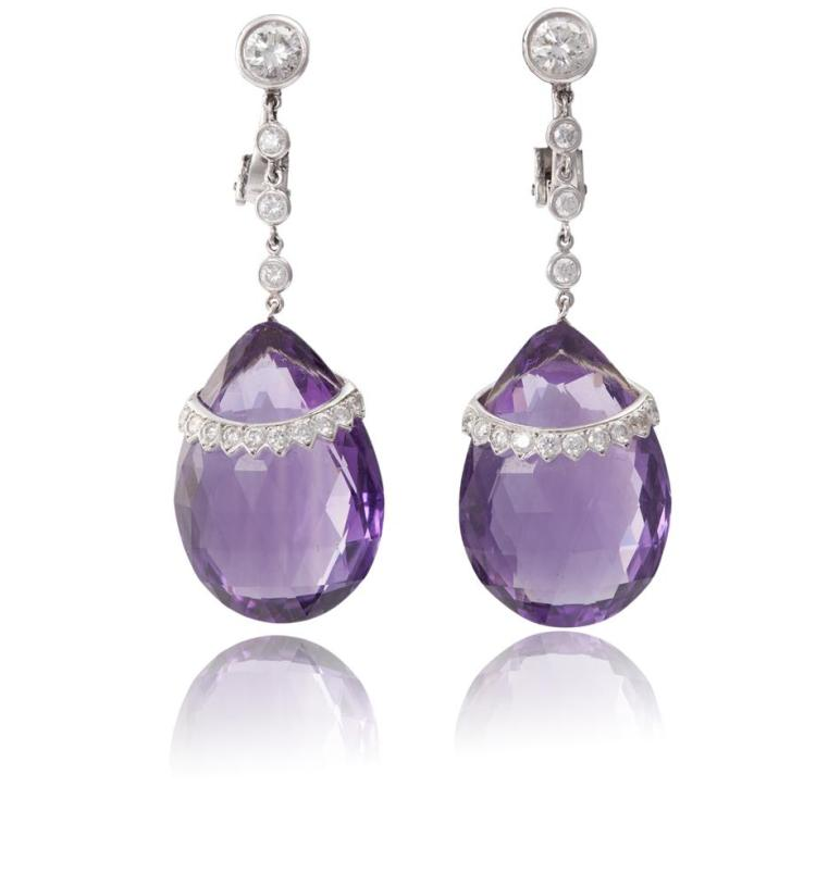 A PAIR OF AMETHYST AND DIAMOND PENDENT EARRINGSThe brilliant-cut diamond surmount suspending a drop set with three round brilliant-cut diamonds and a pear-shaped amethyst briolette, accented with similarly-cut diamonds, diamonds approximately 1.30ct