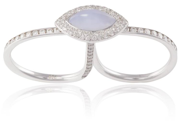 A CHALCEDONY AND DIAMOND DOUBLE RINGThe marquise-shaped cabochon chalcedony to the centre, within a surround of pavé-set diamonds, the two hoops set with similarly-cut diamonds, mounted in 18K gold, diamonds approximately 0.90ct total, ring size O &