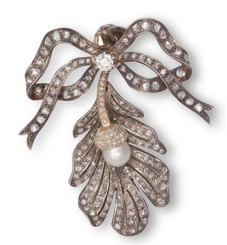 A FINE LATE VICTORIAN DIAMOND AND PEARL PENDANT/BROOCH, CIRCA 1880The highly stylised tied ribbon bow surmount, set throughout with old brilliant and rose-cut diamonds, suspending a similarly-set curving leaf set to the centre with a pearl acorn pen