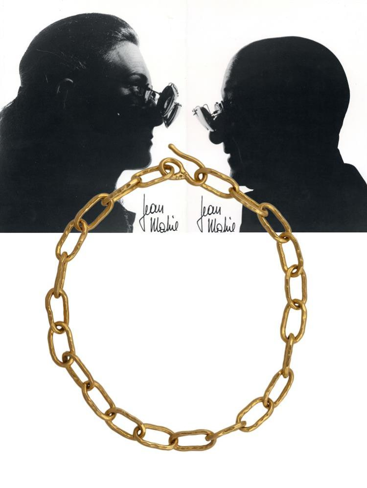 A TWENTY-TWO KARAT GOLD NECKLACE, BY JEAN MAHIE, CIRCA 1970Of Cadene design, set with twenty-two interlocking links of hammered gold, mounted in 22K gold, with maker's mark for Jean Mahie, French assay marks, length 43cm, approximately 131g total,