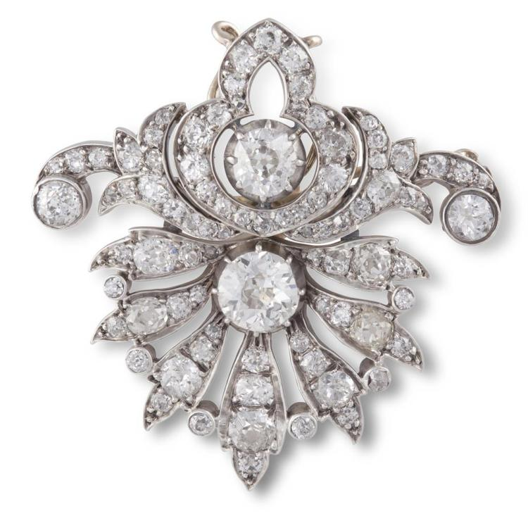 AN EARLY 19TH CENTURY DIAMOND BROOCH, CIRCA 1820Designed as a stylised anthemion motif, set throughout with old brilliant and cushion-cut diamonds, mounted in silver and gold, central diamonds weighing approximately 1.23 & 0.90ct, remaining diamonds