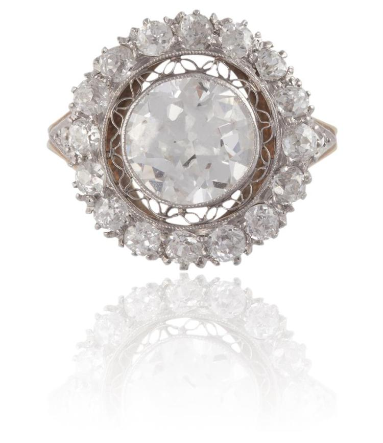 A DIAMOND CLUSTER RINGThe old brilliant-cut diamond weighing approximately 1.80cts, within a surround of similarly-cut diamonds and two old cushion-cut diamond shoulders, within millegrain setting, mounted in 14K gold, remaining diamonds approximate