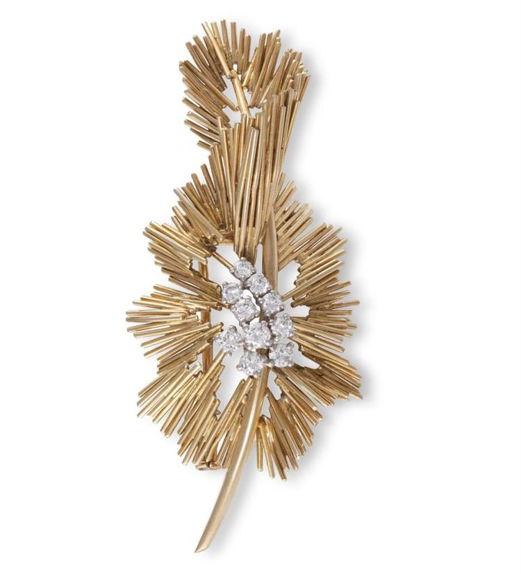 A GOLD AND DIAMOND BROOCH, BY BOUCHERON, CIRCA 1960Designed as a wire work foliate spray, centring a circular-cut diamond bombé cluster, mounted in 18K gold, signed Boucheron Paris, numbered 15137, French assay marks, maker's mark, length 6.1cm