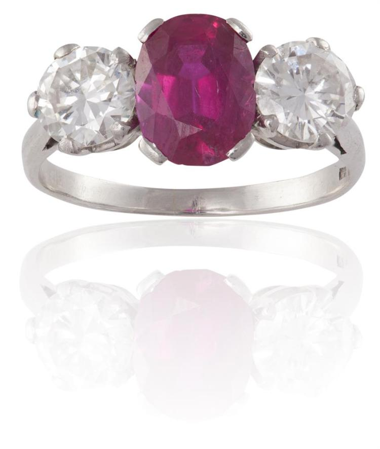 A FINE RUBY AND DIAMOND RINGThe cushion-shaped ruby, weighing approximately 2.30cts, between two round brilliant-cut diamond shoulders, diamonds approximately 1.10cts total, maker's mark, ring size MAccompanied by a report from GCS laboratory, stat