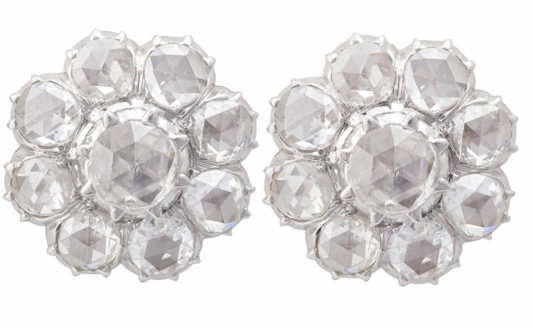 A PAIR OF DIAMOND CLUSTER EARRINGSEach earrings set with a central rose-cut diamond, within a similarly-cut diamond surround, earrings width 1.8cm