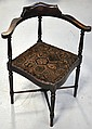An Edwardian stained beech corner chair with