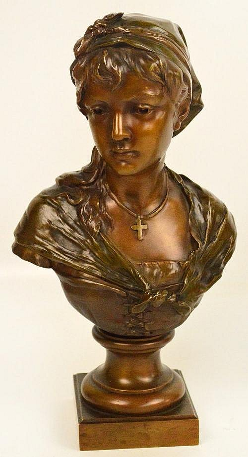 CANAS; a bronze pedestal bust of a young woman