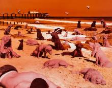 Dogs on the beach, a signed print by Sandy Skoglund