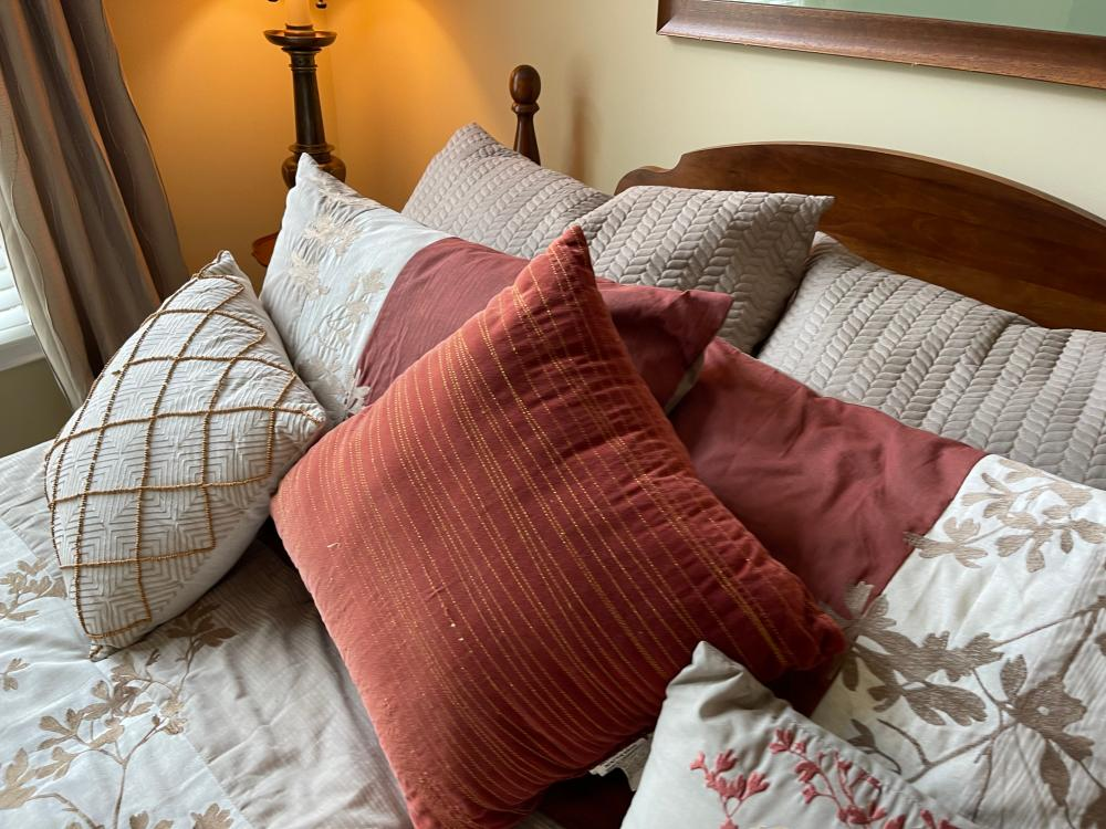 BED SET. INCLUDES FRAME, MATTRESS, BOX SPRING, LINENS AND PILLOWS