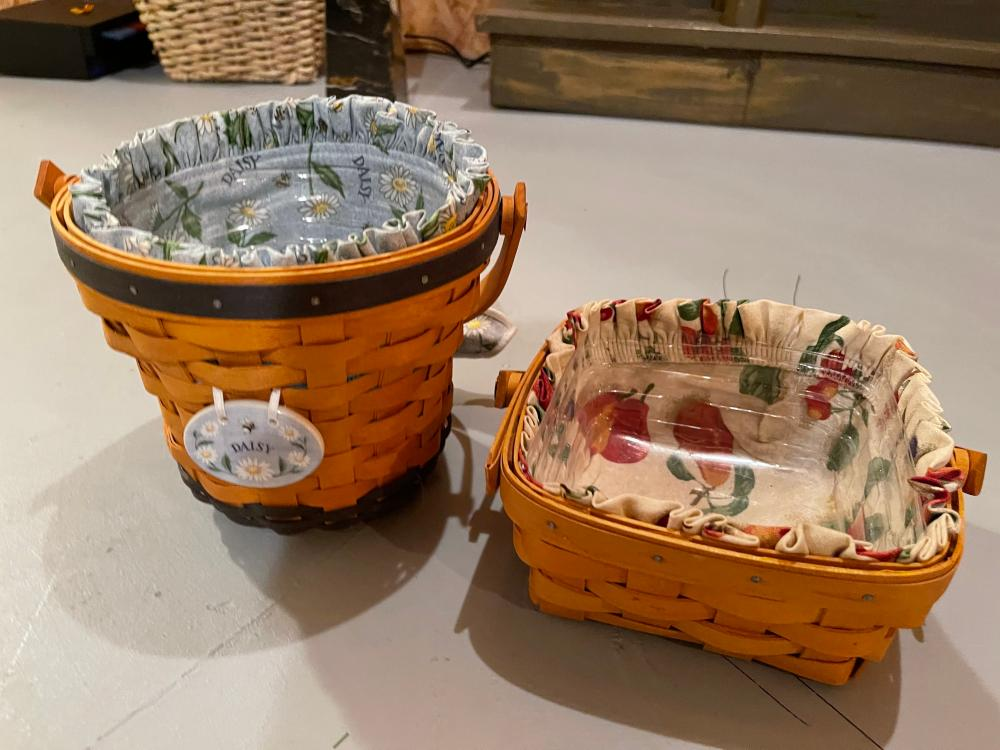 PAIR OF LONGABERGER BASKETS WITH LINERS. 1999 AND 1999.