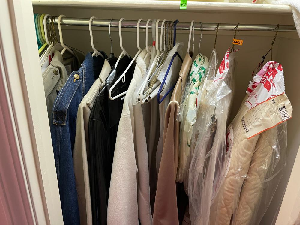 LOT OF MODERN AND VINTAGE JACKETS. SIZE SMALL TO LARGE. BED SKIRT AND COMFORTER. SIZE UNKNOWN.