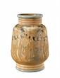 LOUIS LOURIOUX (1874-1930) Important vase en grès à corps tronconique à base et col annelés à décor de lampions et de motifs floraux bleus, orange et verts nuancés noir sur fond ocre. Signature au tampon «Lourioux» et au faune. Vers 1920. H : 45 cm A, Louis Lourioux, Click for value