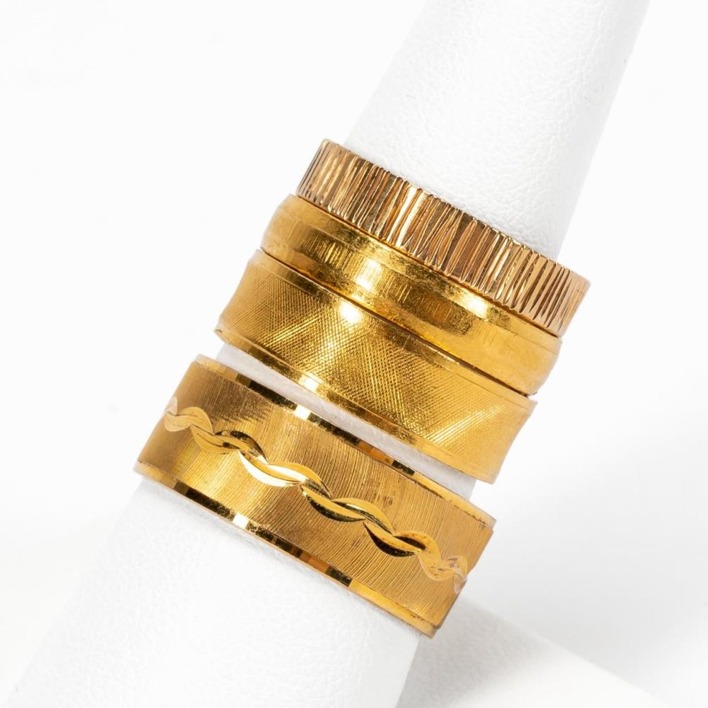FOUR YELLOW GOLD BANDS, THREE 18K & ONE 14K