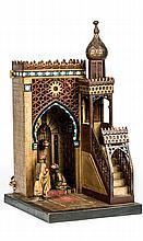 An Anton Chotka Lamp (Austrian, Late 19th/Early 20th Century) - مصباح أنطوان تشوتكا (نمساوي، أواخر القرن 19 - أوائل القرن 20) مجسم لمحراب مسجد مع المنبر مصنوع من البرونز المطلي على البارد، وعليه ختمة الفنان الصانع
