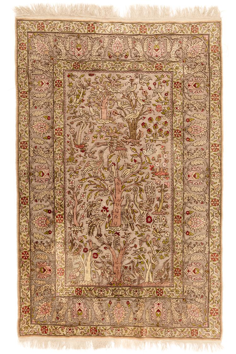 A COPPER AND METAL-WRAPPED THREAD HEREKE SILK RUG WITH BIRD MOTIF