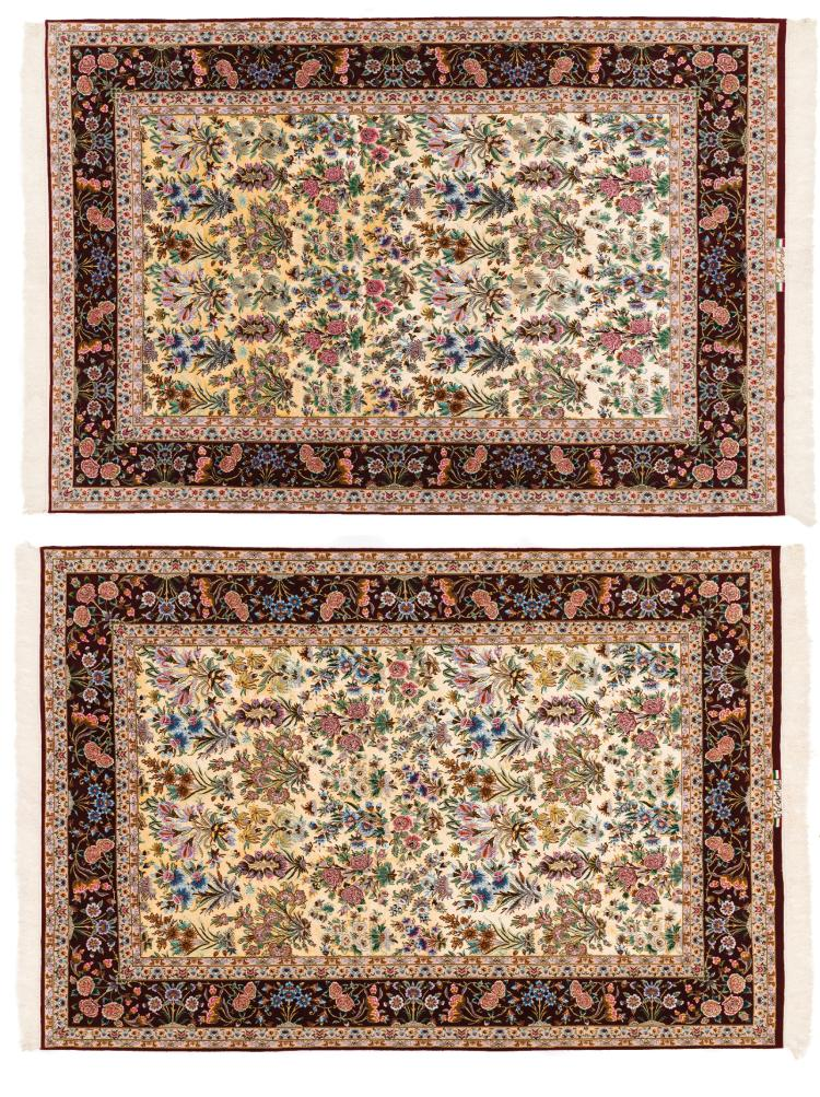 A PAIR OF ISFAHAN HASSAN HUSNI FLORAL ALL-OVER DESIGN CARPETS