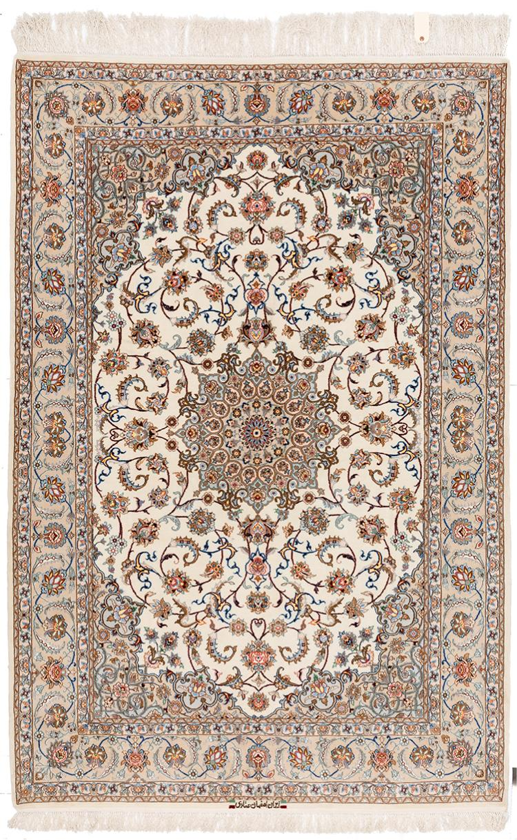 A TRADITIONAL ISFAHAN EMADI WOOL CARPET ON IVORY GROUND