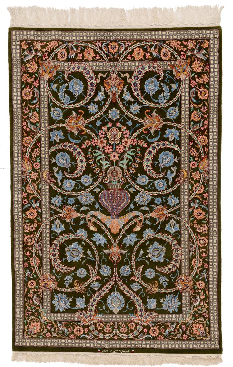 A FINE ISFAHAN HASSAN DAOURI OLIVE GREEN RUG WITH UNIQUE CENTRAL VASE FLOWERING TO SCROLLING VINES AND BIRD MOTIF
