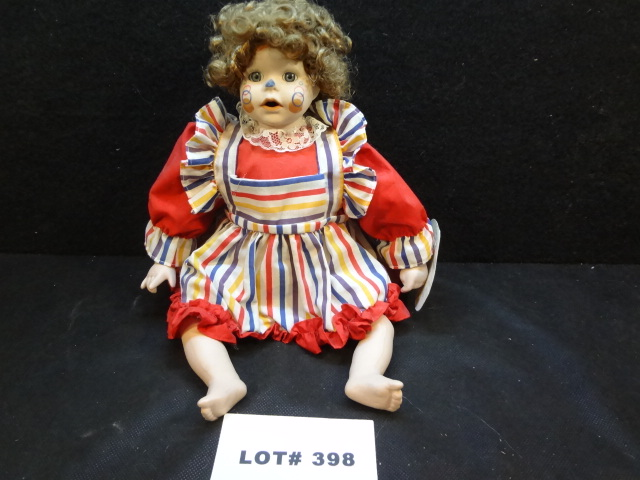 Precious porcelain 'clown' doll by Crowne, 13