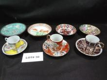 Two Japanese and one Avon teacup and saucer sets