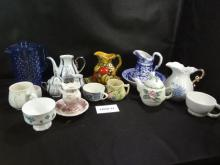 Huge mixed lot of teapots, cups, pitchers and bowls